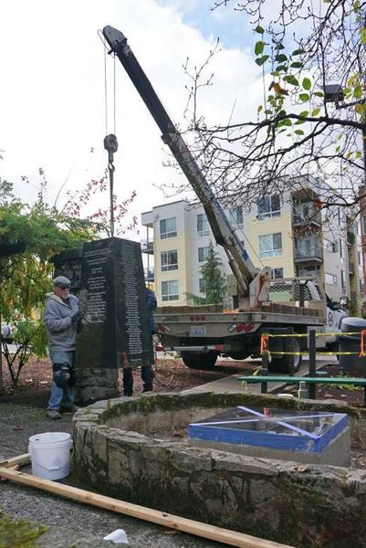 PHOTO COURTESY: AMERICAN LEGION POST 180 - Local sculptor Bruce Palone helps guide the obelisk memorializing Clackamas County veterans of the Vietnam War toward its resting place in Scott Park in downtown Milwaukie.