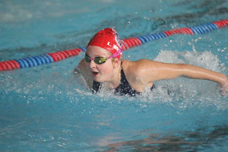 WILL DENNER/MADRAS PIONEER - Lexi Williams, 11, broke four Madras Swim Team records in last Saturday's home meet, including the 50-yard butterfly (above). She has now posted eight state-qualifying times for the OSI Short Course season.