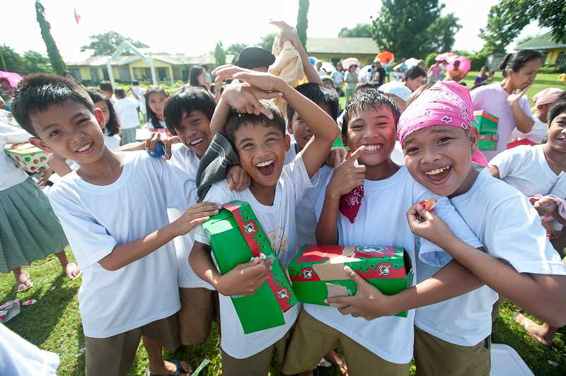 COURTESY OF SAMARITANS PURSE - Children from the Philippines are all smiles during the shoebox distribution for Operation Christmas Child.