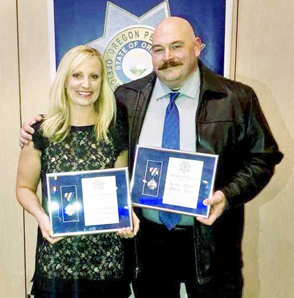 SUBMITTED PHOTO - Newberg-Dundee Police Officers Heather Fults and Nathan James were awarded the Oregon Peace Officers Association Medal of Honor at a banquet held Nov. 4.