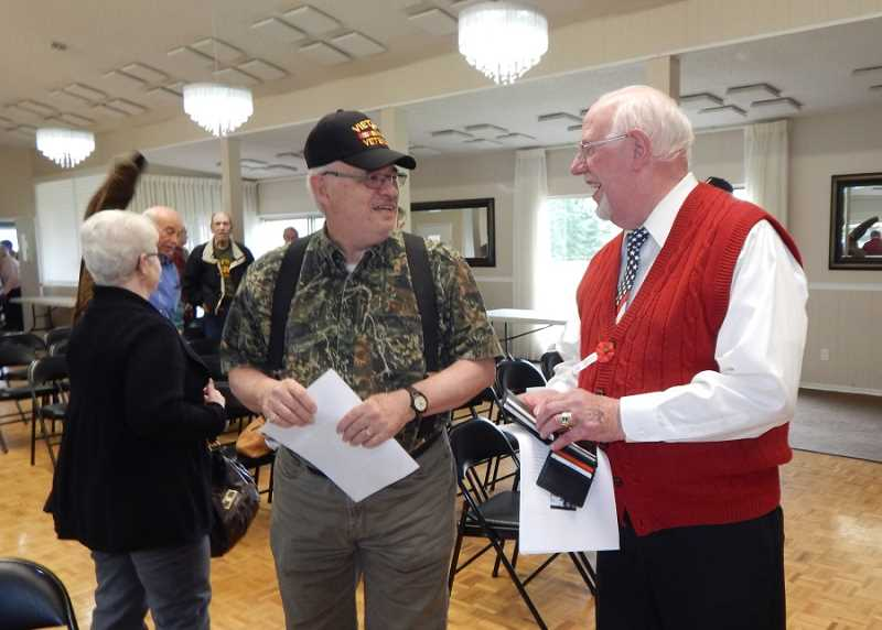 BARBARA SHERMAN - Jerry Larsen (right), a King City resident and Navy veteran, was the keynote speaker at King City's annual Salute to Veterans on Nov. 9, and is shown here chatting with another veteran following the conclusion of the program.