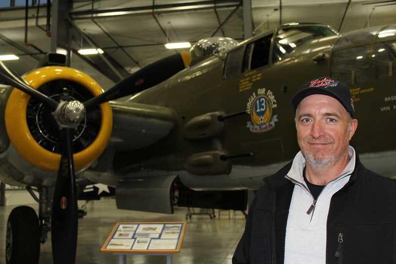 HOLLY M. GILL - Scott Maher, operations director for the Liberty Foundation, which has had the Madras Maiden on tour for the past nine months, stands next to a B-25, similar to the first plane he 'bought into' when he was only 18.