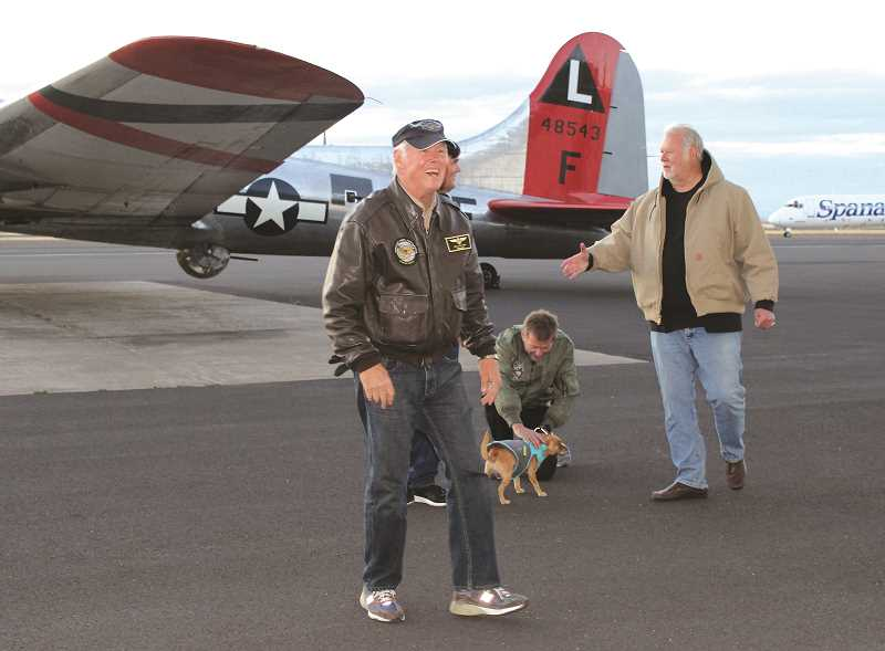 HOLLY M. GILL - Pilots Jim Lawrence (center), and John Hess (behind Lawrence) greet those assembled to watch the aircraft's return at the Erickson Aircraft Collection. The museum loaned the aircraft to the Liberty Foundation for its 2017 Salute to Veterans Tour.