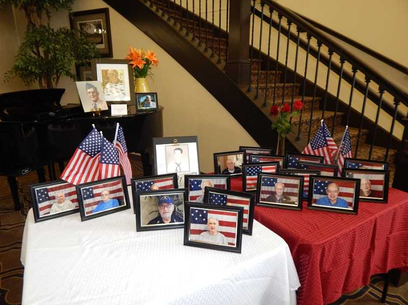 BARBARA SHERMAN - Around the Bonaventure lobby on Veterans Day were groupings of photos of its resident veterans, each one taken in front of a U.S. flag.