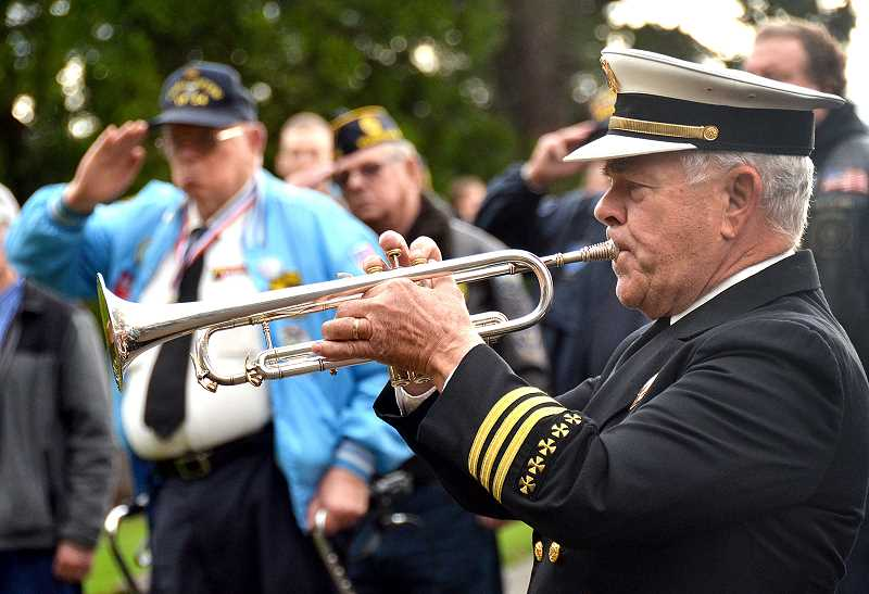 SPOKESMAN PHOTO: VERN UYETAKE - Dave Nelson plays Taps to conclude the ceremony.