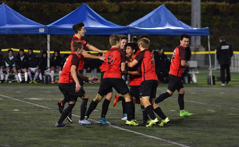 TIMES PHOTO: MATT SINGLEDECKER - The Westview boys soccer team celebrates with Ryan Park after Park put home the first goal of the game in the Class 6A state championship match.