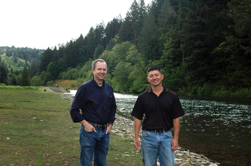 PAMPLIN MEDIA GROUP: FILE PHOTO - Steven Corson and biologist Tim Shibahara, at Faraday Lake, a fishing and camping site owned by PGE that the utility renovated for fish habitats in 2013.