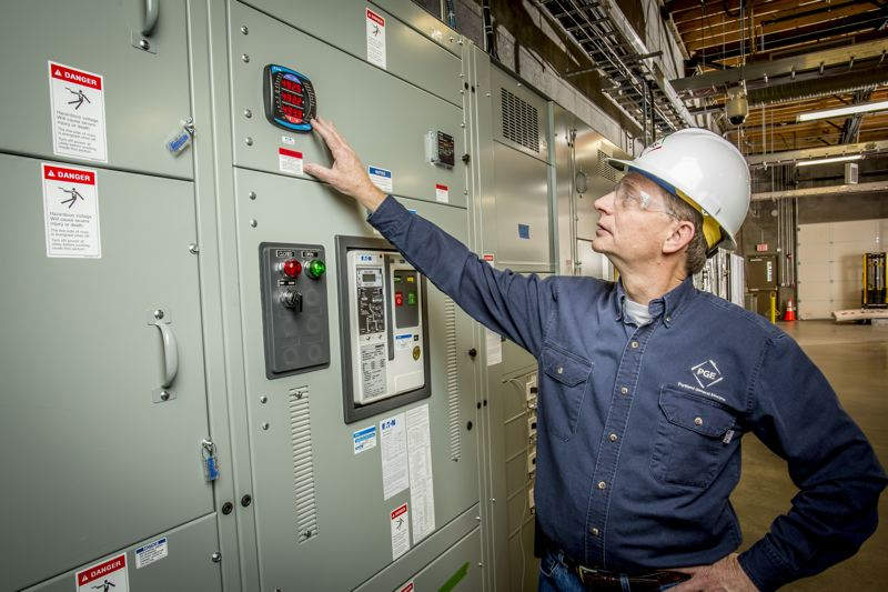 SUBMITTED: PGE - Kevin Whitener at the control panel of the Salem Smart Power Center , which uses state-of-the-art storage batteries and leading edge micro-grid technology to demonstrate how variable renewable energy sources, such as solar and wind power may be stored for later use.
