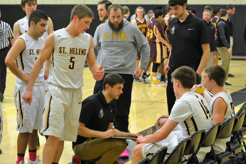 SPOTLIGHT PHOTO: JAKE MCNEAL - Lions boys' basketball coach Jordan Massinger, center, is back for his third year in charge.