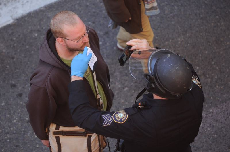 PAMPLIN MEDIA GROUP: JOSH KULLA - Portland police using cellphones to photograph IDs at the June 4 protest downtown Portland.