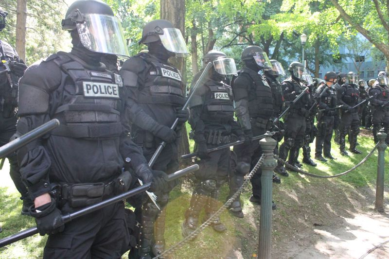 TRIBUNE PHOTO: LYNDSEY HEWITT - Police presence at a June 4 protest downtown Portland.
