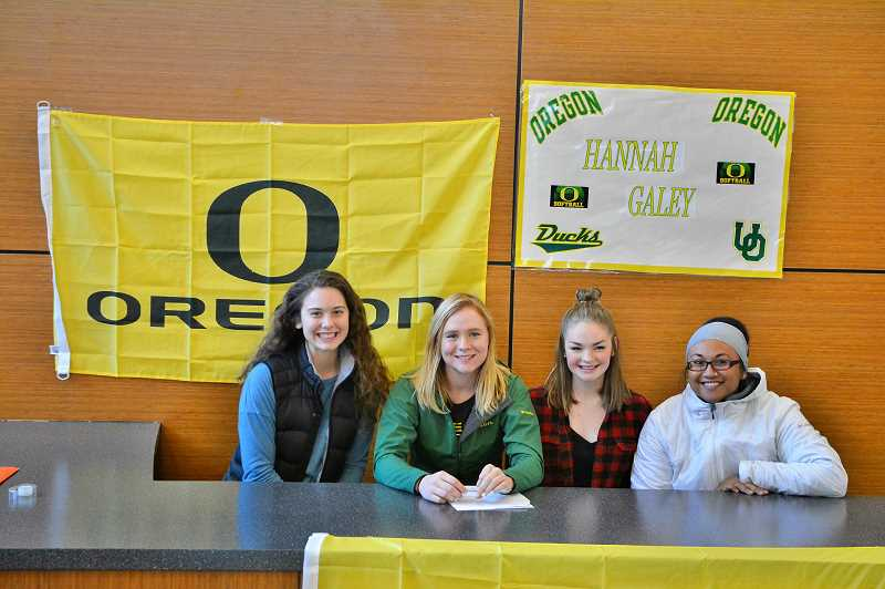 SPOTLIGHT PHOTO: JAKE MCNEAL - From left, Indians seniors Hadley Enos and Hannah Galey, sophomore Taylor Johnson and softball coach Cijay Koler celebrate Galey's signing.