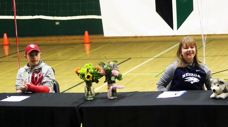 DAN BROOD - Tigard High School seniors Spencer Goodell (left) and Victoria Gailey signed their college letters of intent last week at the school.