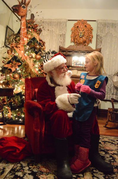 SPOTLIGHT FILE PHOTO - Santa Claus visits with children during the 2016 Christmas Lights ceremony at the Watts House in Scappoose.