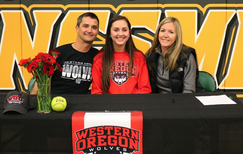 REVIEW/NEWS PHOTO: JIM BESEDA - Putnam's Maddie Mayer (center), celebrated Tuesday alongside parents John and Kathy after she signed a National Letter of Intent to play softball at Western Oregon University next year.