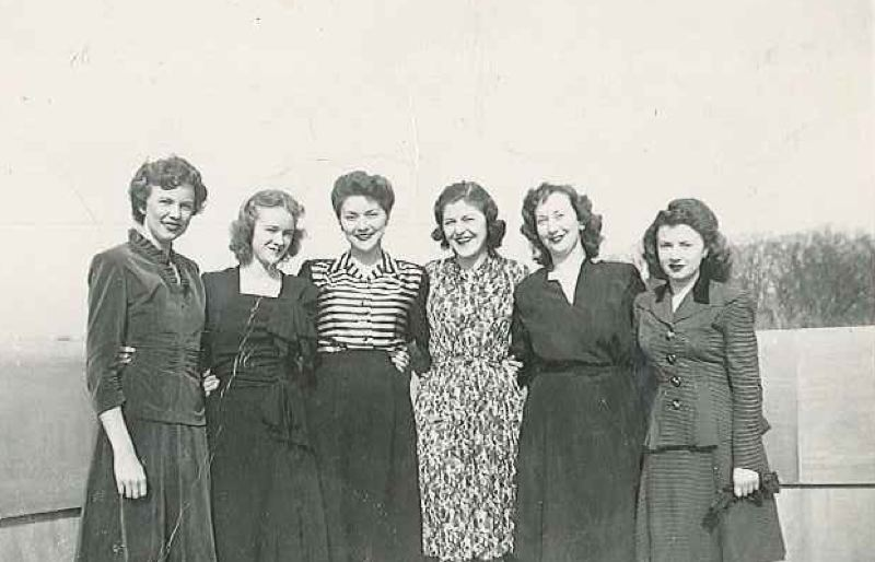 SUBMITTED PHOTO - A photo of Georgie DeLashmutt, far right, on the Washington Street Bridge and some of her coworkers and friends, Lorene, Lillian, Mary, Edith, Neel, who worked with her in Washington, D.C. DeLashmutt said she maintained friendships with many of the women who lived all over the country. In this photo, their first names are scrawled on the back with personal notes about each woman.