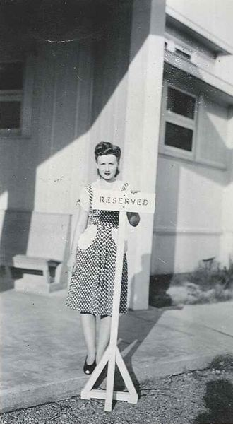 SUBMITTED PHOTO - Georgie DeLashmutt at age 20, standing outside her apartment in Washington, D.C., where she worked as a Japanese codebreaker during World War II. DeLashmutt was one of thousands of women who worked in secrecy during the war to help decipher encoded military messages.