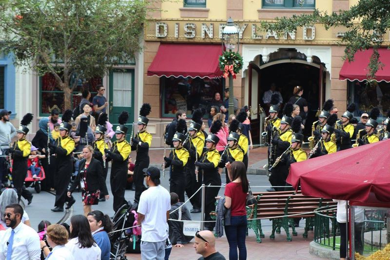 PHOTO COURTESY OF KENDRA GRIFFIN - Members of the St. Helens marching band and color guard take part in the Main Street Parade at the Disneyland theme park in California.