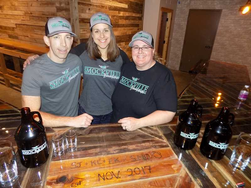 GAZETTE PHOTO: RAY PITZ - Keith Laber, left, and Erin Koenig will run the brewing side of Smockhouse Brewhouse while Shannon Johnson will run the restaurant part in the new business located in the Sherwood Center for the Arts.