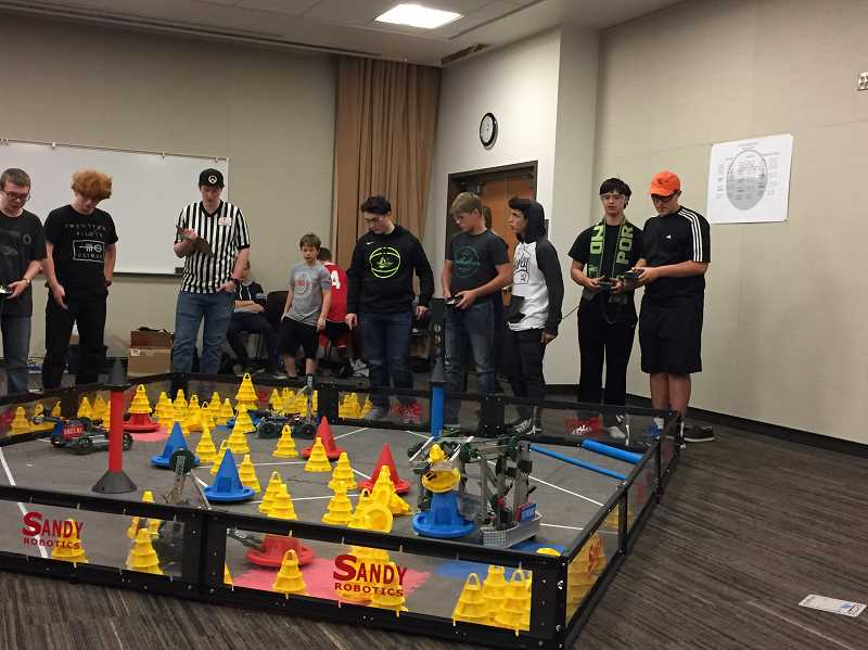 SUBMITTED PHOTO - In the Sandy VEX EDR tournament, Molalla students brought their robots, which they designed and built themselves, to compete against other teams in a game-based engineering challenge.