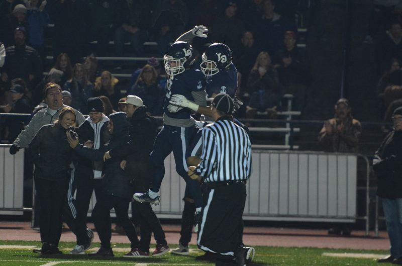 TIMES PHOTO: MATT SINGLEDECKER - Lake Oswego wide receiver Casey Filkins celebrates a big catch against Jesuit in the Class 6A quarterfinals.
