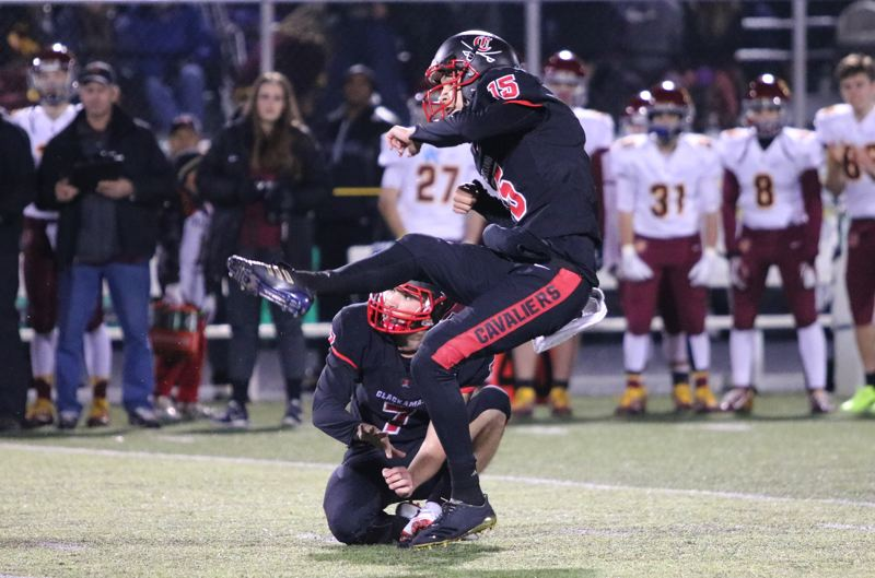 REVIEW/NEWS PHOTO: JIM BESEDA - Clackamas' Jeffrey Nelson (15) and holder Mitchel Modjeski watch as Nelson's 42-yard field goal takes flight with 3:48 to play in Friday's quarterfinal playoff against Central Catholic.