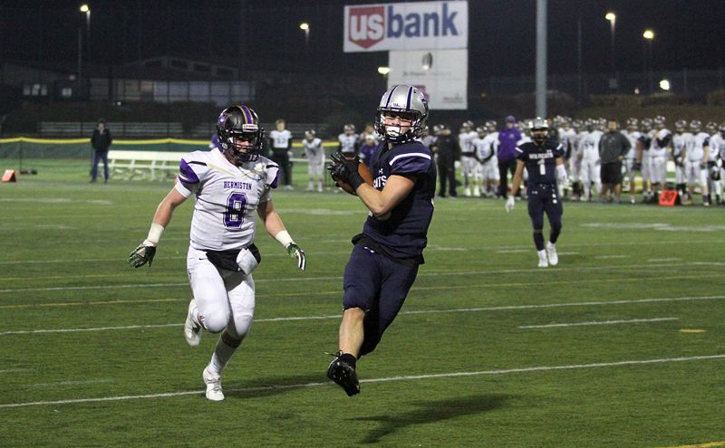 PAMPLIN MEDIA GROUP: MILES VANCE - Wilsonville junior Jonah Gomez flies toward the end zone to score his team's first touchdown in its 35-27 loss to Hermiston in the Class 5A state semifinals at Hillsboro Stadium on Saturday.
