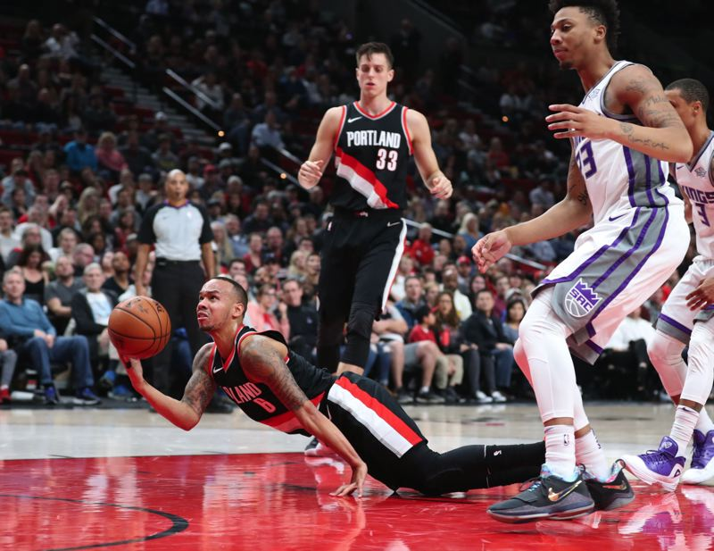 TRIBUNE PHOTO: JAIME VALDEZ - Trail Blazers guard Shabazz Napier tries to put up a shot from the floor after being fouled during Saturday night's home game against Sacramento.
