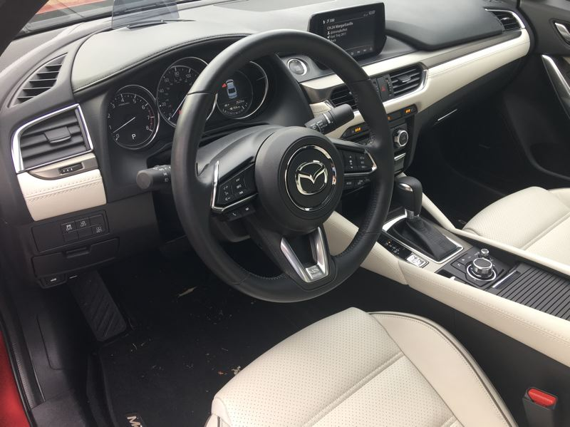 PORTLAND TRIBUNE: JEFF ZURSCHMEIDE - Even in the most basic Sport trim, the 2017 Mazda6 features a 7-inch Mazda Connect touchscreen infotainment system, cruise control, blind spot monitoring and rear cross-traffic alert, rearview camera, keyless entry, and pushbutton start.