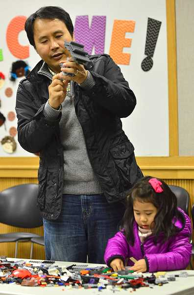 SPOKESMAN PHOTO: VERN UYETAKE - Jea, left, and Stella Park have fun piecing lego together.