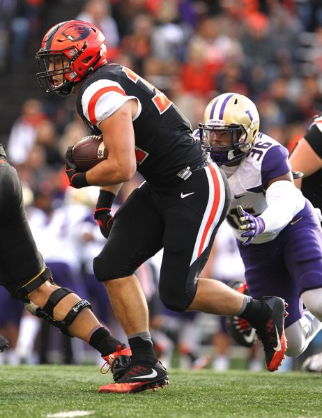 TRIBUNE PHOTO: JAIME VALDEZ - Ryan Nall of Oregon State plows through the Washington defense.