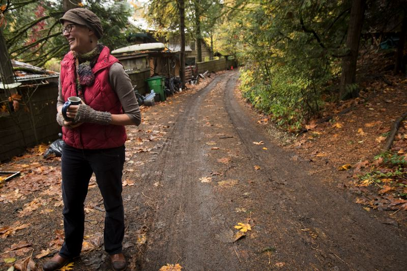 PORTLAND TRIBUNE: JAIME VALDEZ - Brenna Bell looks toward the property of Tryon Life Community Farm that she helped found in Southwest Portland.
