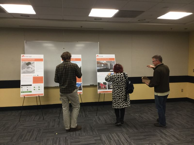 TRIBUNE PHOTO: STEVE LAW - Attendees at a national summit on accessory dwelling units at Portland State University browse displays of innovative ADU designs.