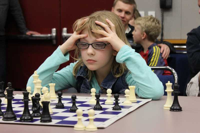 PAMPLIN MEDIA GROUP FILE PHOTO - Meridian Creek Middle School has joined a handful of other district schools with a chess club but is hoping to grow the program with the help of volunteers.