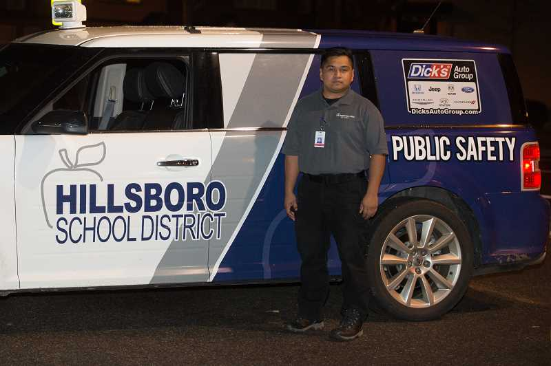 HILLSBORO TRIBUNE PHOTO: CHRISTOPHER OERTELL - Rogelio Evangelista Sevada patrols the Hillsboro School District on Nov. 14. The district has launched its own police agency, the Department of Public Safety, with its own chief of police to oversee safety across the district's 42 properties.