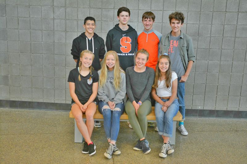 SPOTLIGHT PHOTO: JAKE MCNEAL - CROSS COUNTRY: Back row, from left: All-leaguers Gustavo Villalvazo, Josh Lull, John Kavulich and Isaiah Ebert. Front row, from left: All-leaguers Emma Jones, Tessa Davidson, Linnaea Kavulich and Tess Conway. Not Pictured: All-leaguer Georgia Benner.