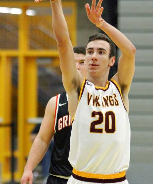 NEWS-TIMES FILE PHOTO - Forest Grove's Kyle Thompson shoots a free throw during a Vikings game at Forest Grove High School last season.