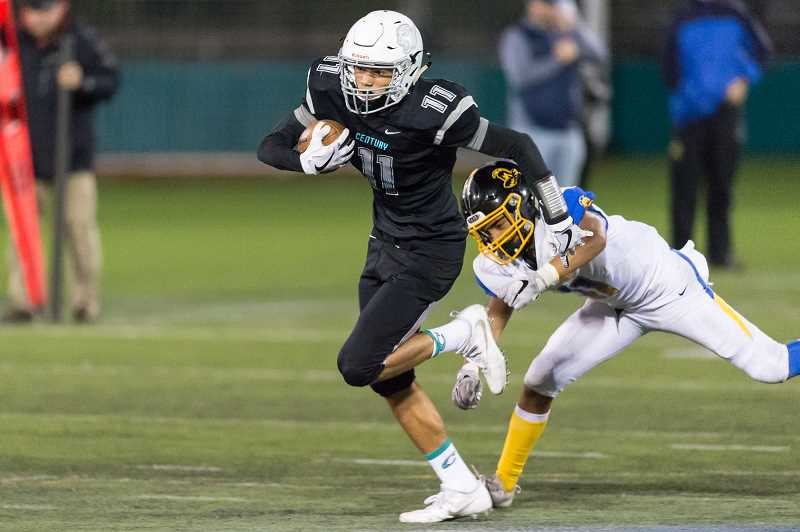 HILLSBORO TRIBUNE PHOTO: CHRISTOPHER OERTELL - Century's Chance Sparks carries the ball during a game against Aloha earlier this season. Sparks was the only sophomore selected to the all-Metro first-team.