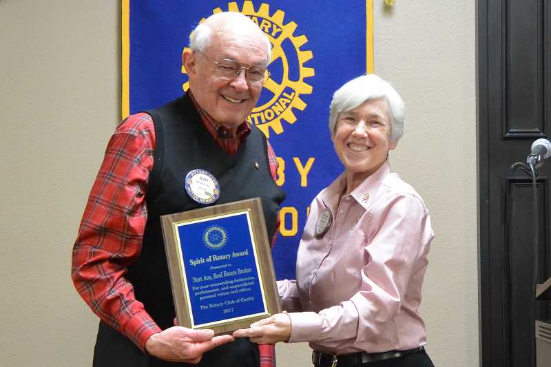 Burt Aus (left) receives the Spirit of Rotary award from Kathleen Jordan, this year's Canby Rotary President.