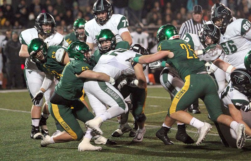 TIDINGS PHOTO: MILES VANCE - The West Linn defense — here taking down Tigard's Jake Leavitt on Friday — was the state's best among Class 6A teams this year, allowing fewer than 11 points per game over 12 contests.