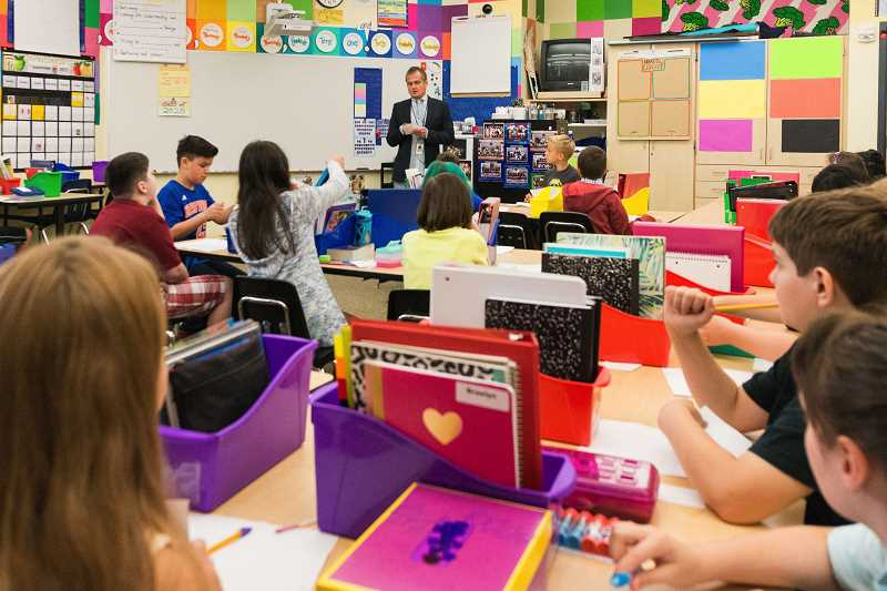HILLSBORO TRIBUNE FILE PHOTO - Olga Acuña, Hillsboro School Districts director of community outreach, says that a rise in homless students isnt unexpected, given rising housing costs across the area. Pictured, teacher Brett Cunningham speaks with 5th-graders on the first day of school at Orenco Elementary in September.