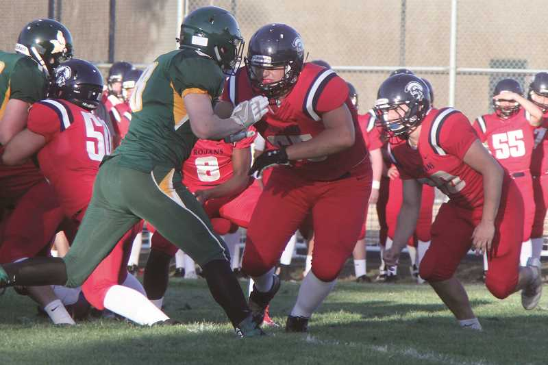 PHIL HAWKINS - Nick Suing, First Team offensive and defensive lineman