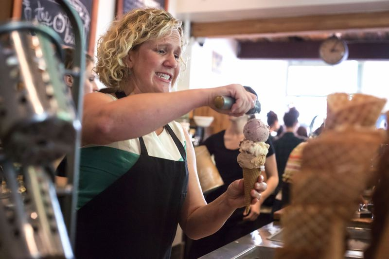PAMPLIN MEDIA GROUP: FILE PHOTO - Kim Malek, owner of Salt and Straw, scoops a cone at the Northwest 23rd Avenue ice cream shop.