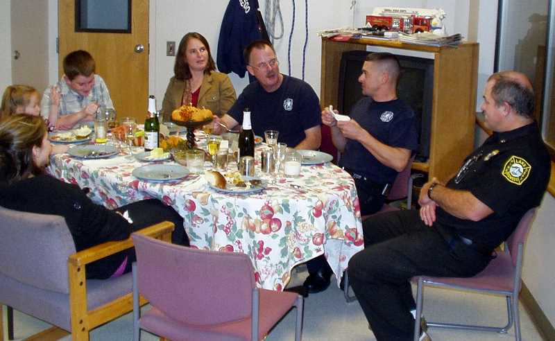 SUBMITTED PHOTO: GREG BARNUM - Lake Oswego firefighter Brian McVicker was joined at the fire station a few years ago by his wife and children for a sit-down Thanksgiving meal with colleagues Troy Waddell and Brad Loehner.
