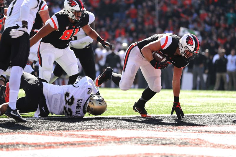 TRIBUNE PHOTO: JAIME VALDEZ - Ryan Nall of Oregon State plows into the end zone against Colorado.