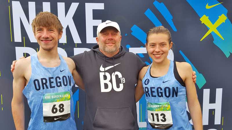 PHOTO CREDIT: DEBBIE HUMPHREY - Indians seniors John Kavulich, left, and Linnaea Kavulich, right, enjoy time with Scappoose cross country coach Dave Harley.