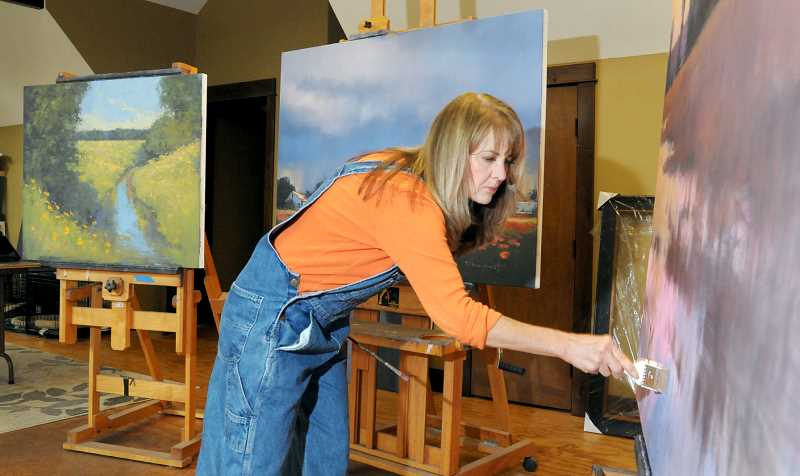 GARY ALLEN - Romona Youngquist works recently on three oil paintings destined for a show in Scottsdale, Ariz. She often works on multiple paintings at the same time, she said.