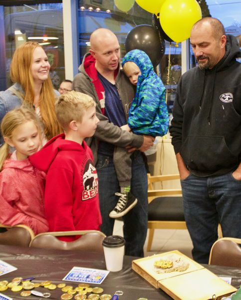 OUTLOOK PHOTO: CHRISTOPHER KEIZUR - Many families came to meet Dozer Dave Turin, who took photos to raise money for SnowCap Community Charities.