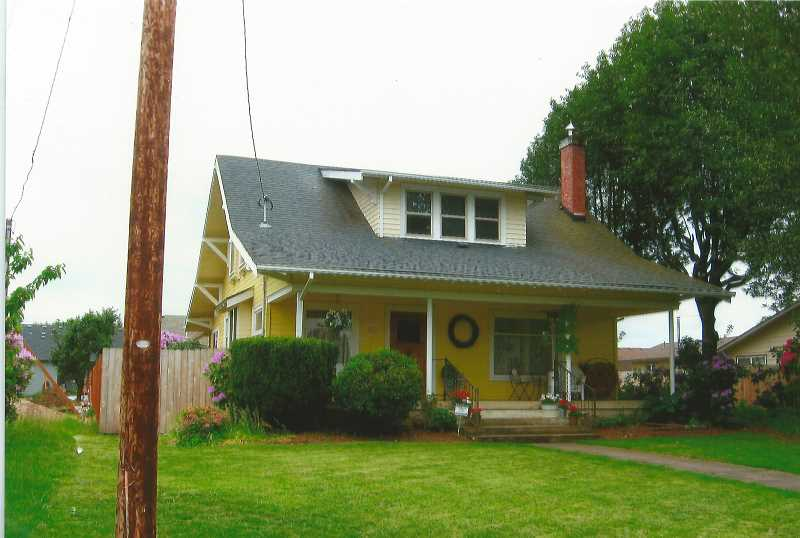 PHOTO COURTESY OF GAIL MCCORMICK - Today, the William Walter and Annie Everhart House is in excellent condition for its 100 years. The craftsman bungalow style house is a yellow color, the same as the original.