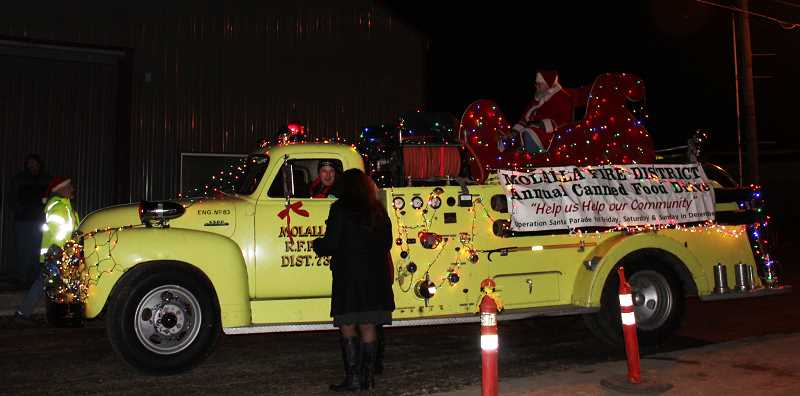 PIONEER FILE PHOTO - Pictured is the old fire truck at Molalla's 2016 tree lighting.